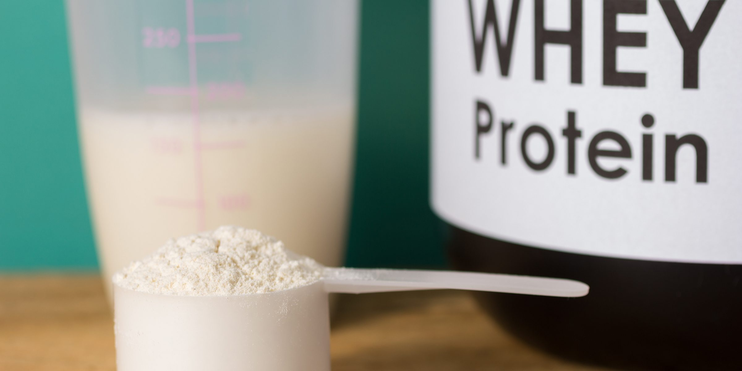 close-up-of-whey-protein-in-spoon-on-table