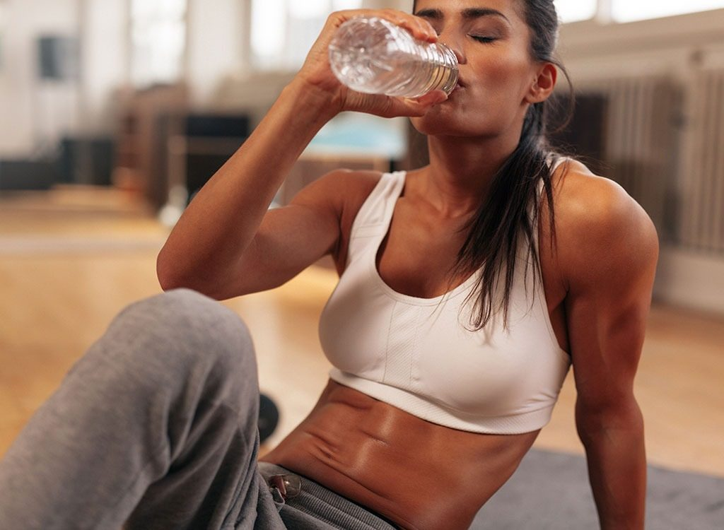 woman-drinking-water-workout-6353843